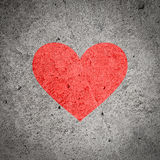 Painted red heart on dark grey concrete wall, textured background Stock Photos