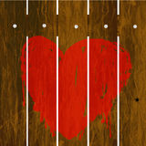 Painted red heart over wooden fence Royalty Free Stock Image