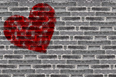 Painted Red Heart Shape on Black Brick Wall Stock Photography