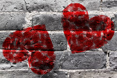 Painted Red Heart Shape on Black Brick Wall Stock Photo