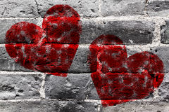 Painted Red Heart Shape on Black Brick Wall Royalty Free Stock Images