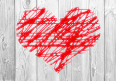 Painted red heart on white wooden background Stock Photography