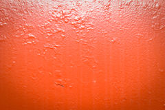 Painted red metal with dirt streaks stock images