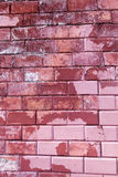 Painted with red paint bricks Stock Photo
