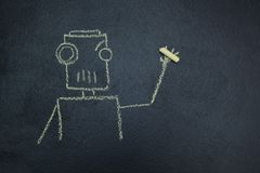 Painted robot on a blackboard with chalk in hand royalty free illustration