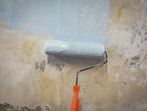 Painted roller wall. With hand Stock Image
