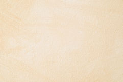 Painted rough paper background. Rough paper painted beige background Stock Photo