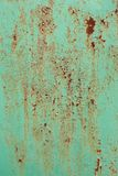 Painted rusted metal with crackling. Grungy surface. Great for backgrounds and layers Royalty Free Stock Photography