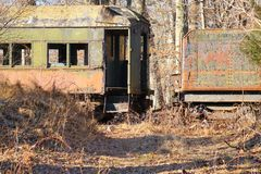 Painted rustic passenger coach cars on rails royalty free stock photography