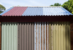 Painted and rusty corrugated iron. Used to make the roof and walls of a shed, SHOT purposely to create a shadow that looks like saw teeth. Copyspace stock photo