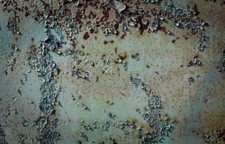 Painted rusty metal background. Flaky, painted metal texture in green and brown royalty free stock image