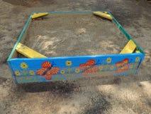 Painted sandbox after rain Royalty Free Stock Image