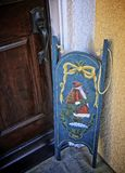 Sled. Painted Santa sled at front door as decoration  in winter Royalty Free Stock Photos