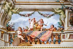 Painted scene of Cherubini, from Royal Palace of Caserta. Playing putti, detail from ceiling frescoes in Hall of Summer, by Fedele Fischetti 1732-1792, Royal Royalty Free Stock Photos