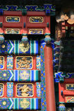 Painted and sculpted patterns decorate a gate (China) royalty free stock photo