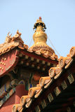Painted and sculptured patterns decorate the facade and the roof of a buddhist temple in Beijing (China). Painted and sculptured patterns decorate the facade and royalty free stock image