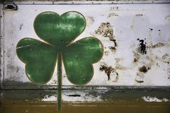 Painted shamrock on a body car Stock Images