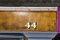 A painted shop number 44 in a village location. royalty free stock photos