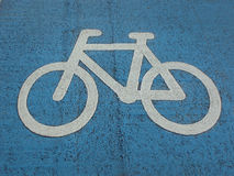 Painted sign of bicycle painted on the road Stock Images