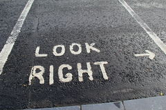 Painted sign on roadway,advising one to look right before crossing Stock Photo