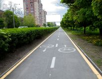 Painted signs on asphalt for bicycle dedicated lanes. A separate bike path in the city.  stock photos