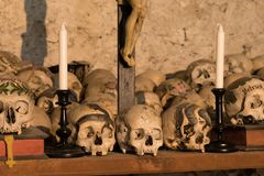 Painted skulls with names, candles and cross Stock Image