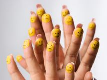 Painted Smilies on Fingertips stock images
