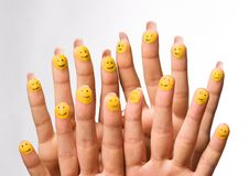 Painted Smilies on Fingertips Royalty Free Stock Images