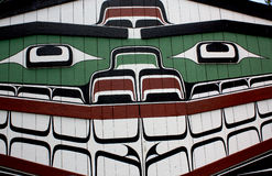 Painted Smiling Indian Longhouse. Longhouse of western north america. Painted planks of smiling animal representation Royalty Free Stock Photo