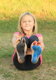 Painted soles of a little kid - girl Stock Photography