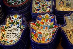 Painted souvenir plates on the counter in the store of Jerusalem, Israel. National ornament on a plate in the form of Hamsa.  stock image