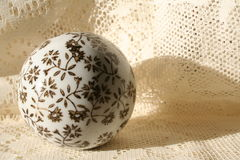 Painted Sphere. Decroative sphere set on a lace background Royalty Free Stock Photo