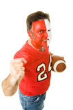 Painted Sports Fan Aggressive. Football fan in face paint and jersey waving his fist aggressively.  Isolated on white Royalty Free Stock Photo