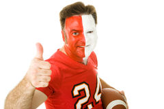 Painted Sports Fan Thumbsup. Football fan in jersey and face paint giving a thumbs up sign.  Isolated on white Royalty Free Stock Photography
