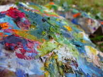 Painted stone with a brush Stock Photo