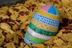 Painted stone egg Stock Image