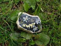 Painted Stone, Hashtag Happy, #Happy, Beautiful Rock stock photos