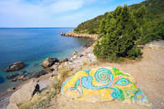 Painted stone on the shore of the Black sea. Royalty Free Stock Photo