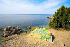 Painted stone on the shore of the Black sea. Stock Photo