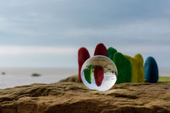 Painted stones and crystal ball Royalty Free Stock Photo