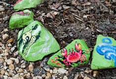 Painted stones, green paint with a pattern Royalty Free Stock Photo
