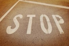 Painted STOP sign. STOP sign painted on a asphalt road surface Stock Photography