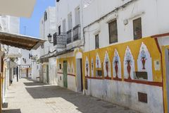 Painted street in Tetouan, morocco. Painted houses in a street of Tetouan, Morocco, bright yellow colors Stock Images
