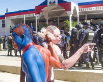 Painted supporters of president Michel Martelly dancing Royalty Free Stock Image