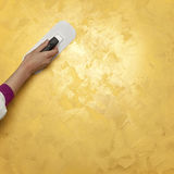 Painted surface with hand Stock Image
