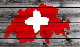 Swiss Cross on wood stock photography
