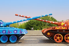 Painted tanks with crossed trunks Stock Photo