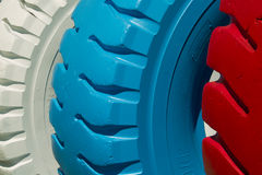 Painted tires. Old truck tire painted bright colors. Picture taken 12.08.2012 Royalty Free Stock Images