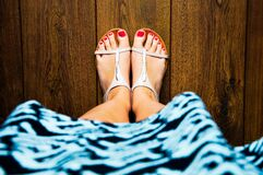 Painted toenails in sandals Stock Image