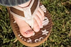 Painted toes. A young girl's foot with newly painted toenails royalty free stock photos